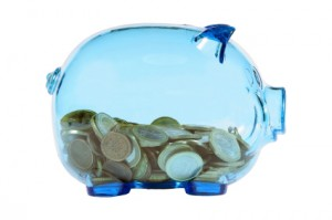 Blue transparent piggy bank with euro coins.